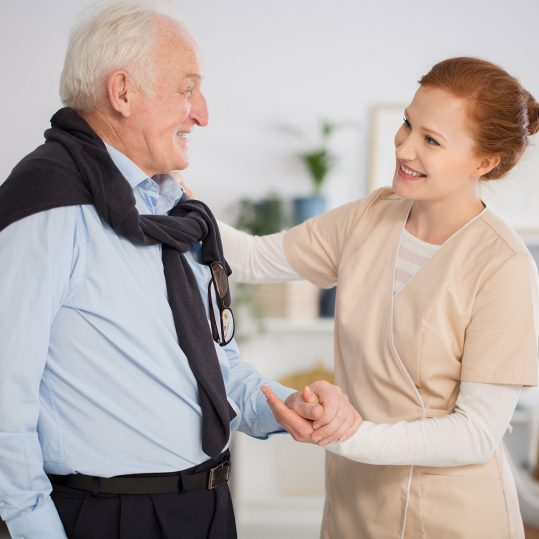 caregiver-helping-senior-man-PD3VNQJ_1920_1280